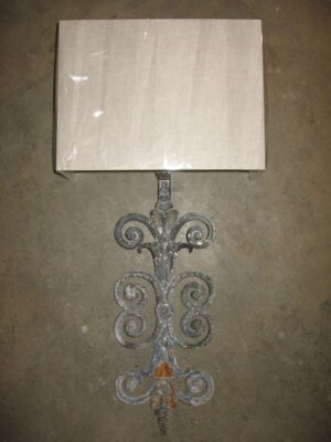 Ferro Designs LLC custom iron wall sconce with a gray, distressed finish. Paired with a half rectangle linen lamp shade.