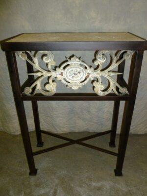 Custom iron console table by Ferro Designs LLC with a dark iron finish and a tile top.