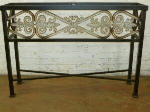 Custom iron console table by Ferro Designs LLC with a dark iron finish.