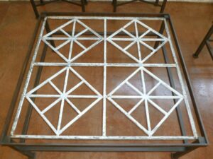 Ferro Designs LLC custom iron coffee table with a dark iron base finish and a white, distressed cast iron top.