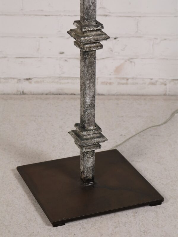 Custom iron floor lamp with a gray, distressed finish and a dark iron base.