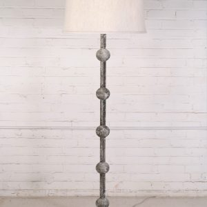 Custom iron floor lamp with a white, distressed finish and a dark iron base. Paired with a 19 inch linen drum lamp shade.