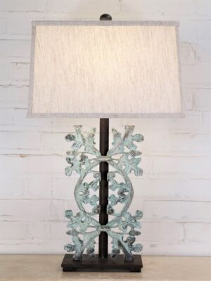 Oak leaves custom iron table lamp with a patina green finish and a dark iron base. Paired with a 15 inch rectangle linen lamp shade.