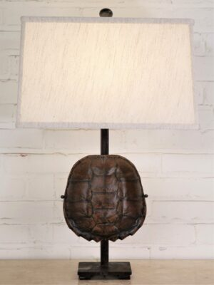 Custom iron table lamp with a turtle shell and a dark iron base. Paired with a 16 inch rectangle linen lamp shade.