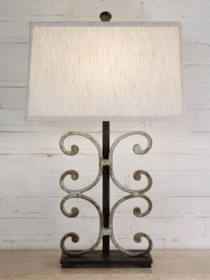Baroque custom iron table lamp with a white, distressed finish and a dark iron base. Paired with a 16 inch rectangle linen lamp shade.