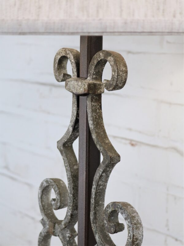 Scroll custom iron table lamp with a white, distressed finish