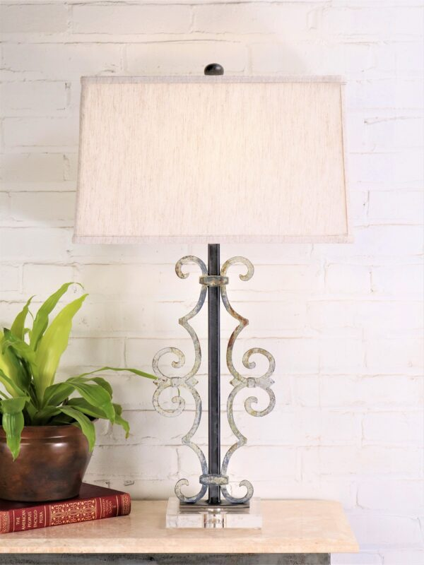Scroll custom iron table lamp with a white, distressed finish on an acrylic base
