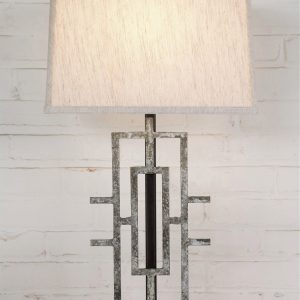 Geometric custom iron table lamp with a white, distressed finish on a dark iron base. Paired with a 14 inch rectangle linen lamp shade.