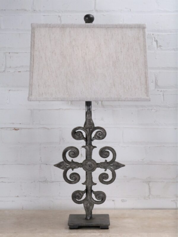 Cross custom iron table lamp with a gray, distressed finish on a dark iron base