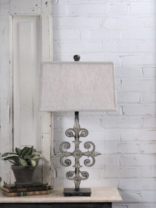 Cross custom iron table lamp with a white, distressed finish on a dark iron base