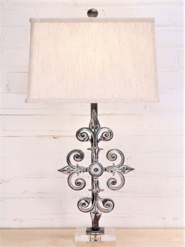 Cross custom iron table lamp with a white, distressed finish on an acrylic base