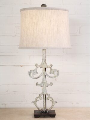 Flowering vine custom iron table lamp with a white, distressed finish and a dark iron base. Paired with a 12 inch linen drum lamp shade.