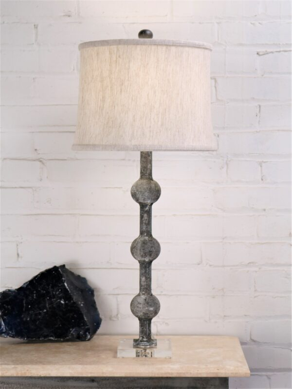 28 inch tall spheres custom iron table lamp with a gray, distressed finish and an acrylic base. Paired with a 12 inch drum linen lamp shade.