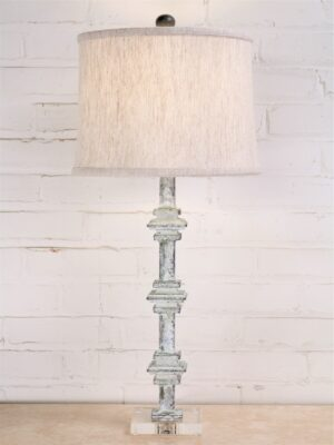 28 inch tall square collar custom iron table lamp with a white, distressed finish and an acrylic base. Paired with a 12 inch linen drum lamp shade.