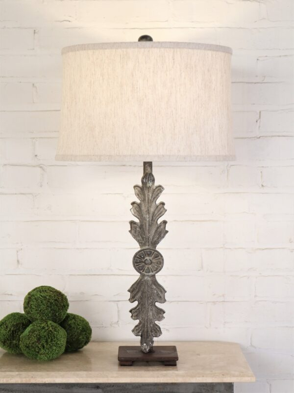 Leaf custom iron table lamp with a gray, distressed finish on a dark iron base. Paired with a 15 inch drum linen lamp shade