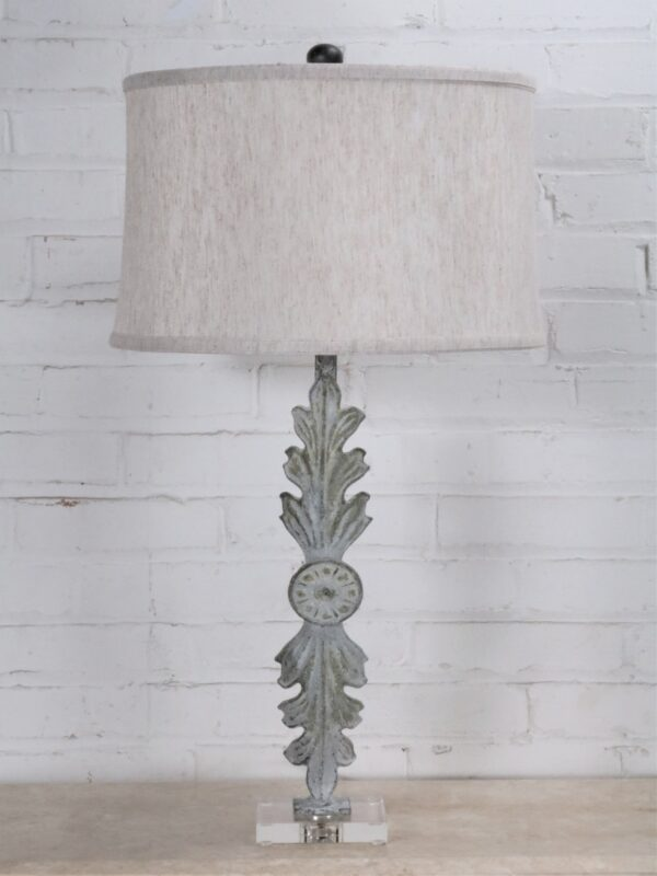 Leaf custom iron table lamp with a white, distressed finish on an acrylic base. Paired with a 15 inch linen drum lamp shade.
