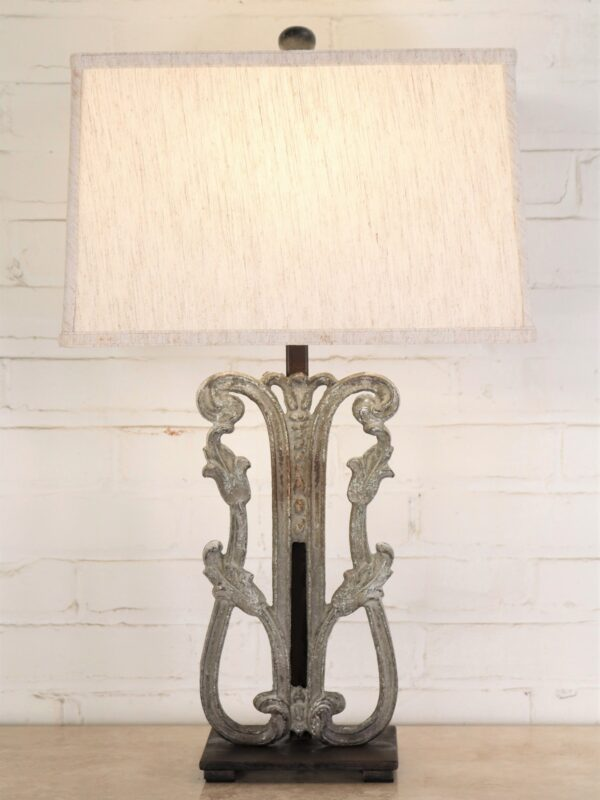 Tulip custom iron table lamp with a gray, distressed finish and a dark iron base. Paired with a 16 inch rectangle linen lamp shade.