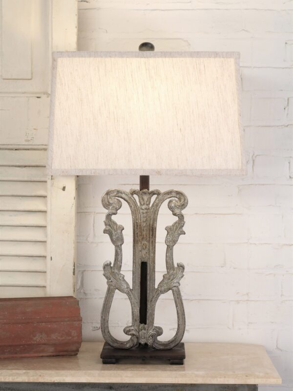 Tulip custom iron table lamp with a gray, distressed finish and a dark iron base. Paired with a 16 inch rectangle linen lamp shade
