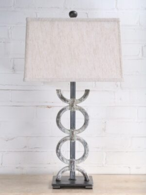 Rings custom iron table lamp with a white, distressed finish and a pewter base. Paired with a 14 inch rectangle linen lamp shade.