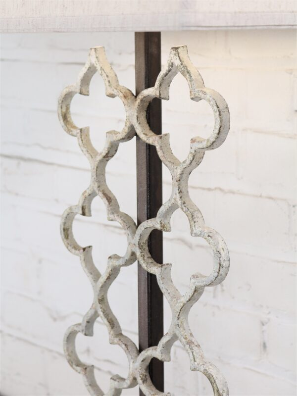 Quatrefoil custom iron table lamp with a white, distressed finish.
