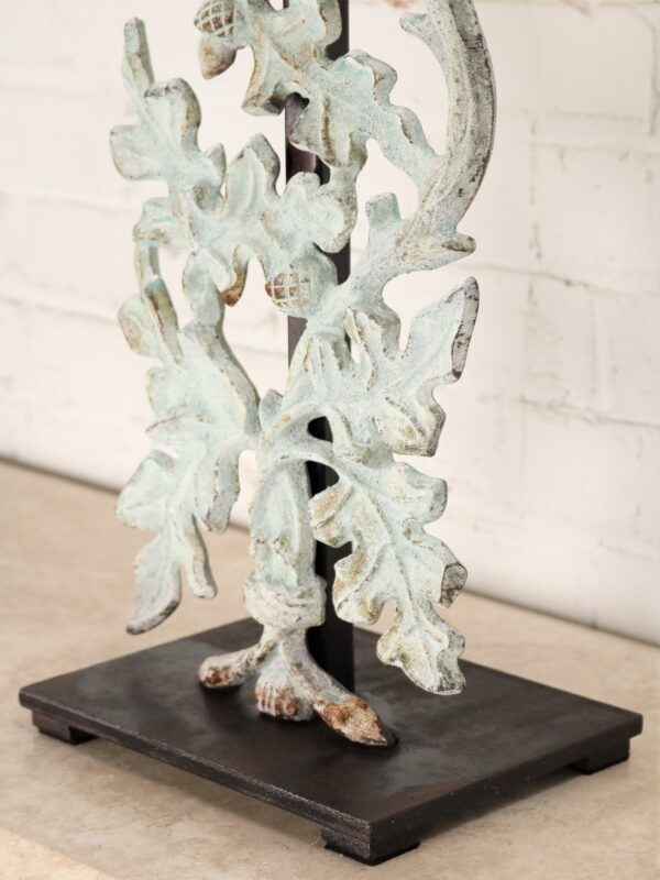 Oak leaves custom iron table lamp with a patina green finish and a dark iron base.