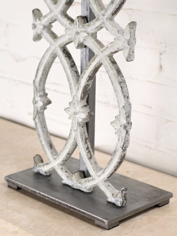 Cathedral custom iron table lamp with a white, distressed finish and a pewter base.