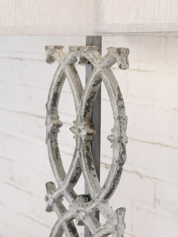 Cathedral custom iron table lamp with a white, distressed finish.