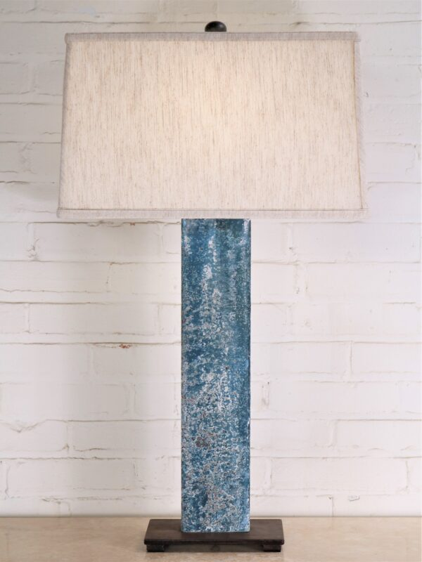 32 inch tall rectangle post custom iron table lamp with a blue, distressed finish and a dark iron base. Paired with a 17 inch rectangle linen lamp shade.