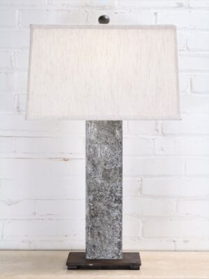 30 inch tall rectangle post custom iron table lamp with a gray, distressed finish and a dark iron base. Paired with a 16 inch rectangle linen lamp shade.