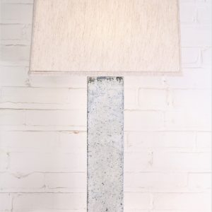 30 inch tall rectangle column custom iron table lamp with a white, distressed finish and an acrylic base. Paired with a 17 inch rectangle linen lamp shade.
