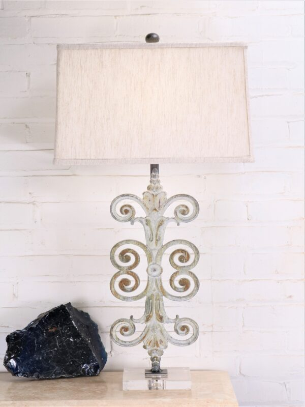 Fleur Scroll custom iron table lamp with a white, distressed finish and an acrylic base. Paired with a 17 inch rectangle linen lamp shade.