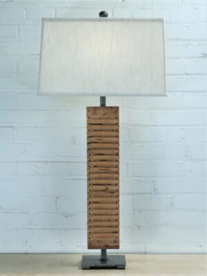 Cigar mold custom iron table lamp with a pewter base. Paired with a 17 inch rectangle linen lamp shade.