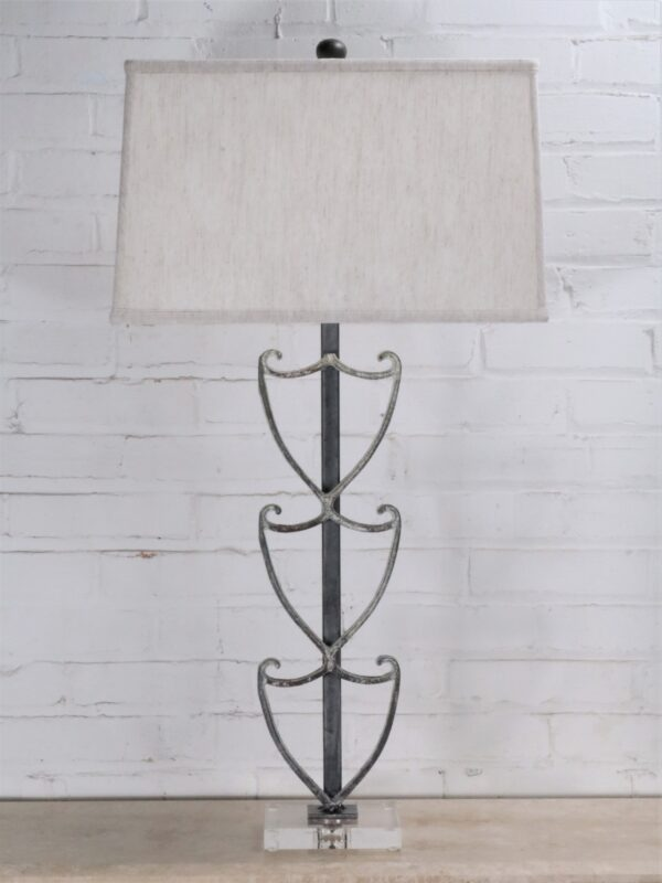 Shield custom iron table lamp with a white, distressed finish and an acrylic base. Paired with a 16 inch rectangle linen lamp shade.