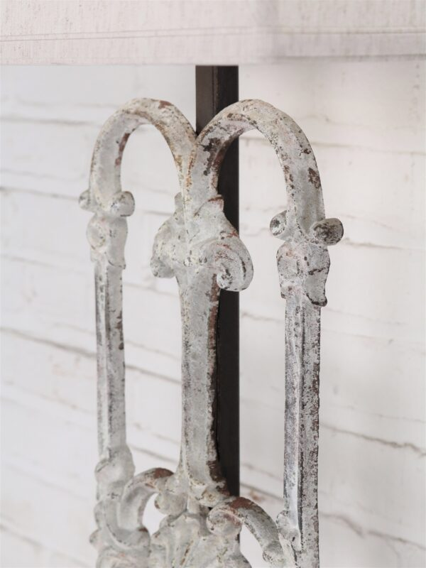Shell custom iron table lamp with a white, distressed finish.