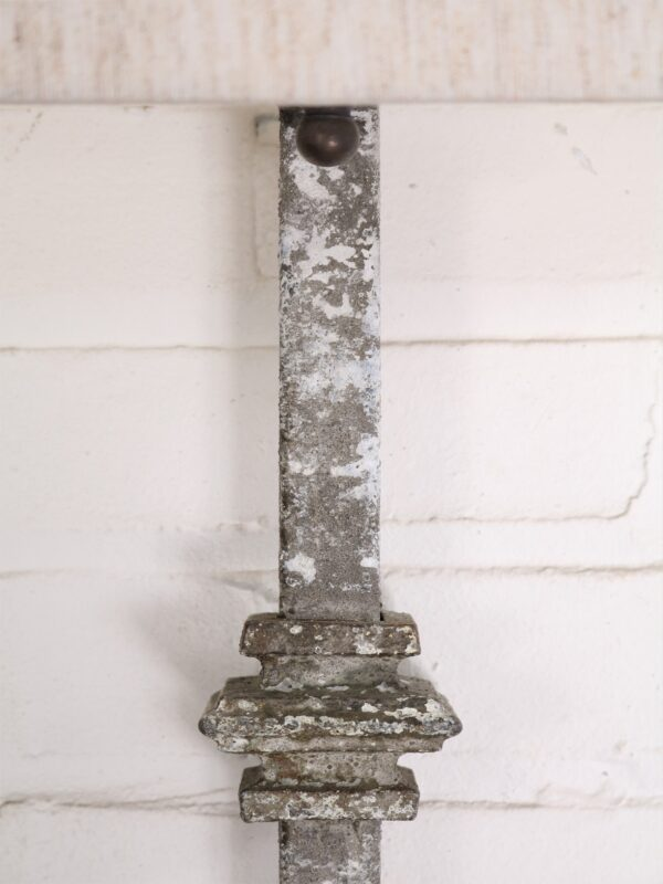 Custom iron wall sconce with a white, distressed finish.