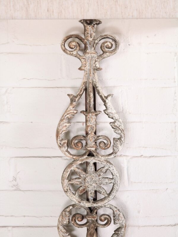 Spanish style custom iron wall sconce with a white, distressed finish.