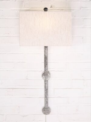 Small sphere custom iron wall sconce with a white, distressed finish. Paired with a half rectangle linen lamp shade.