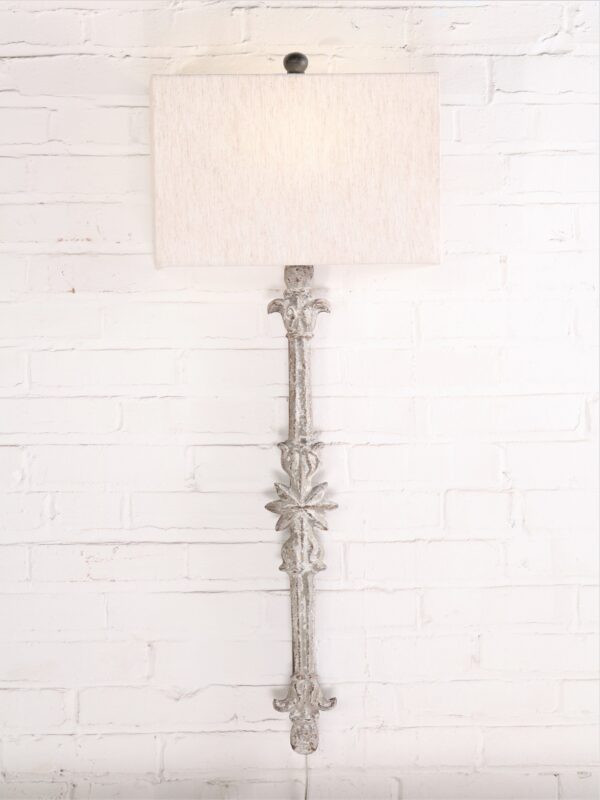 Star custom iron wall sconce with a white, distressed finish. Paired with a half rectangle linen lamp shade.