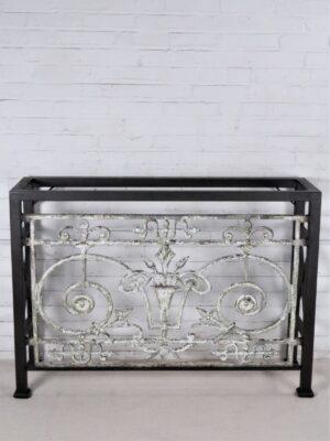 Custom iron console table by Ferro Designs LLC with a dark iron base finish.