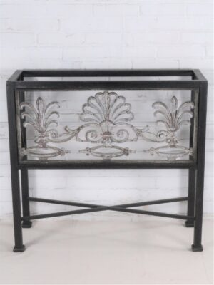 Custom iron console table by Ferro Designs LLC with a dark iron base finish and a white, distressed cast iron inset.