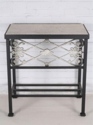 Ferro Designs LLC custom iron bedside table with a dark iron base finish and a travertine tile top
