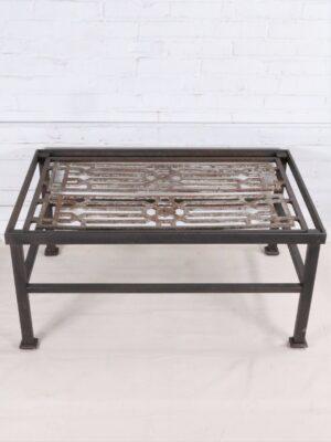 Ferro Designs LLC custom iron coffee table with a dark iron base finish.