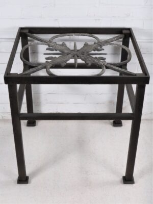 Ferro Designs LLC custom iron end table with a dark iron base finish and a distressed cast iron top.
