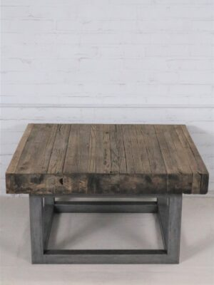 Ferro Designs LLC custom iron coffee table with a steel base finish and a reclaimed factory flooring top.