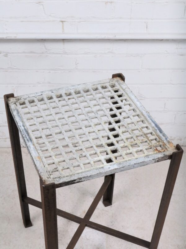 Ferro Designs LLC custom iron drink table or end table with a white, distressed finish and a dark iron base.