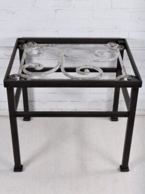 Ferro Designs LLC custom iron end table with a dark iron base finish and a white, distressed cast iron top.