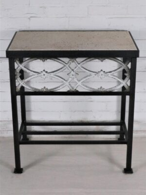 Ferro Designs LLC custom iron bedside table with a dark iron base finish and a travertine tile top.