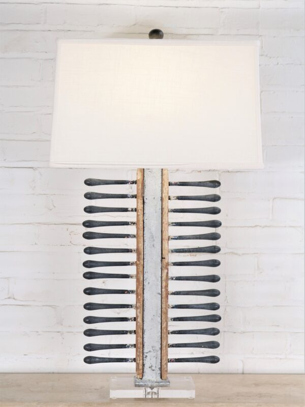 Handcrafted table lamp made from vintage balloon molds with a white distressed finish and a linen lamp shade.